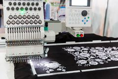 Sewing machine in work, textile fabric, nobody. Factory production, sew manufacturing, needlework technology Royalty Free Stock Photography