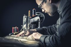 Sewing machine worker. Detail of sewing machine worker stock image