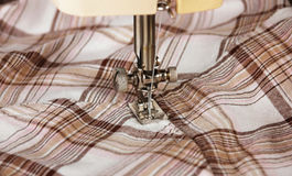 Sewing machine with fabric Stock Photography