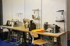 Sewing Machines. Industrial Sewing Machines in Clothing Production Factory royalty free stock images