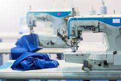 Sewing machines, nobody, cloth industry. Factory production, sew manufacturing Clothing fabric Stock Photos