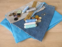 Sewing material with fabric, twine and buttons Stock Images