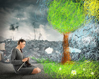 Sewing nature on pollution Royalty Free Stock Image