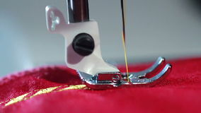 Sewing needle stitching pattern on fabric. Industrial sewing machine stock video