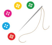 Sewing needle and thread with buttons Royalty Free Stock Image