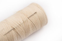 Sewing needle on thread Royalty Free Stock Photos