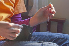 Sewing With Needle and Thread Royalty Free Stock Images