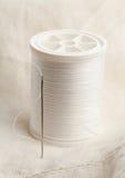 Sewing needle and thread macro Stock Image