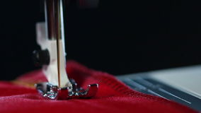 Sewing needle with thread at working sewing machine stock footage