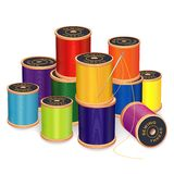 Sewing Needle and Threads, bright colors. Silver needle, stack of 11 spools of thread in vivid colors,  on white background for sewing, tailoring, quilting Royalty Free Stock Photos