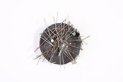 Sewing needles on a round magnet Royalty Free Stock Images