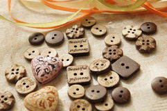 Sewing and needlework. Button. Buttons from the tree on the fabric. Natural color. All Sewing Stock Photo