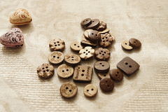Sewing and needlework. Button. Buttons from the tree on the fabric. Natural color. All Sewing Royalty Free Stock Photos