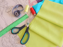 Sewing and needlework. Desk of fashion designer clothes.Modeling and designing clothes Stock Photo
