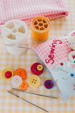 Sewing and Needlework. Sewing needles threads and buttons with a pin cushion royalty free stock image
