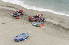 Sewing Networks. NERJA, MALAGA PROVINCE, SPAIN - APRIL 17, 2013: Fishermen sewing fishing nets on the beach in Nerja, Malaga Province, Spain Stock Photos