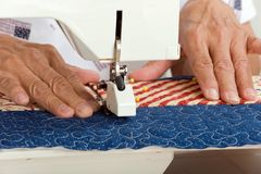 Sewing over multiple layers. Royalty Free Stock Photo