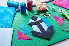 Sewing patchwork of block anchor surrounded by accessories Stock Photo