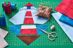 Sewing patchwork of block of lighthouse surrounded by accessorie Stock Photography