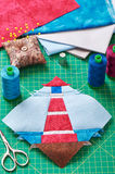 Sewing patchwork of block of lighthouse surrounded by accessorie Royalty Free Stock Photo