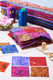 Sewing patchwork blocks to colorful batik quilt Royalty Free Stock Photography