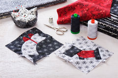 Sewing patchwork of blocks white cat and black dog, sewing accessories Royalty Free Stock Photo