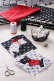 Sewing patchwork of blocks white cat and black dog, sewing accessories Royalty Free Stock Image