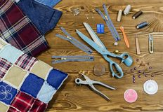 Sewing and patchwork tools on wooden textured background,. Accessory of the tailor and patchwork - sewing background Royalty Free Stock Images