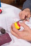 Sewing pelota balls. Expert hands crafting  leather balls for traditional pelota sport Stock Image
