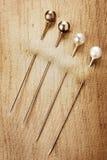 Sewing pins Stock Photos