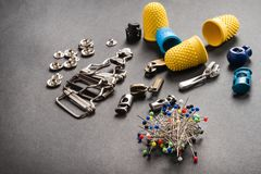Sewing pins on dark background royalty free stock images