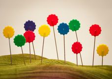 Sewing pins field of flowers. Sewing pins representing a field of flowers, with a shallow depth of focus Stock Image