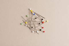 Sewing Pins with Heads of Various Colors Royalty Free Stock Photos