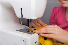 The sewing process. On an electric sewing machine stock photos