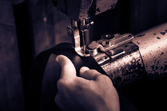 Sewing process of the leather belt. Royalty Free Stock Photo
