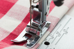 Sewing process. Sewing machine with acessories royalty free stock image