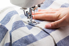 Sewing Process. The sewing machine and fabric stock photo