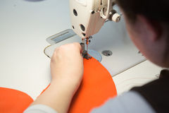 Sewing process on a manufacture Stock Photography