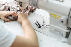 Sewing process on a manufacture Stock Photos