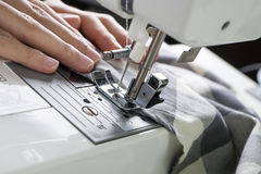 Sewing Process , the sewing machine sew women's hands sewing mac. Hine royalty free stock image