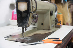 Sewing. Process - Women's hands behind her royalty free stock images