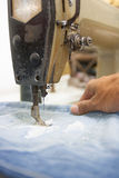 Sewing. Process - Women's hands behind her royalty free stock photos