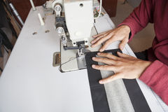 Sewing Process - Women's hands behind her sewing Stock Image