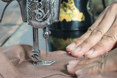 Sewing Process - Women`s hands behind her sewing stock image