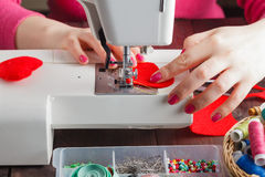 Sewing Process - Women's hands behind her sewing, toy made Stock Photography