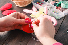 Sewing Process - Women's hands behind her sewing, toy made Royalty Free Stock Image