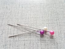 Sewing push pins. Many sewing push pins on background Stock Photo