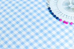 Sewing push pins and pin cushion fabric background Royalty Free Stock Images