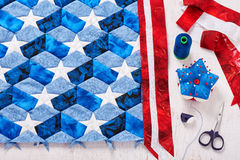 Sewing of quilt with stylized elements of American flag Stock Photo