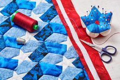 Sewing of quilt with stylized elements of American flag Royalty Free Stock Photography